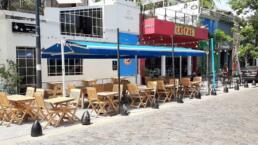 Toldos a Dos Aguas, brazos invisibles, en local comercial, bar en Palermo