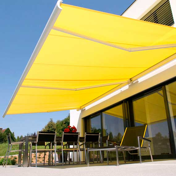 Toldo brazos invisibles f brica de cortinas roller black for Toldos de brazos invisibles