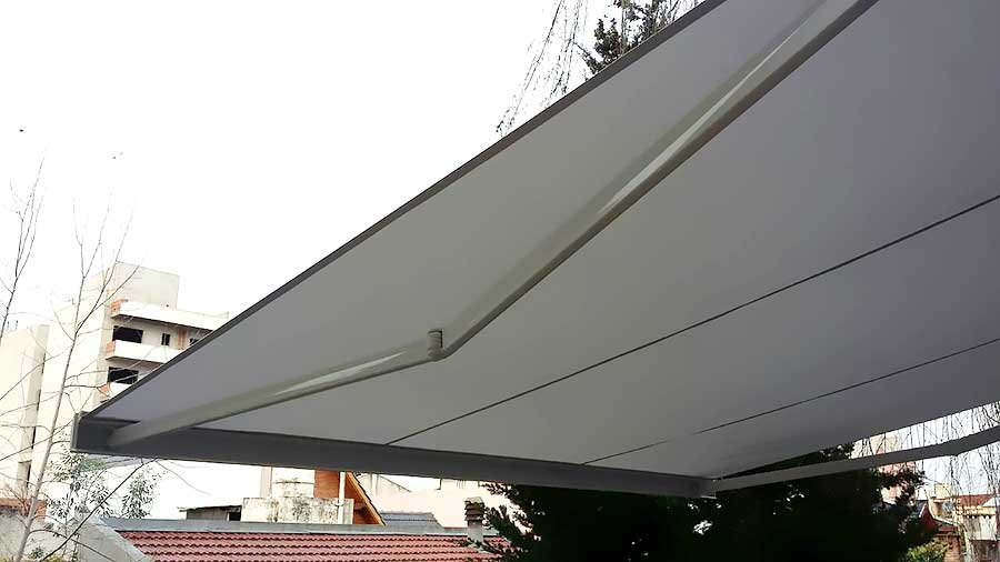 Toldo Cofre Brazos Invisibles BAT vista lateral